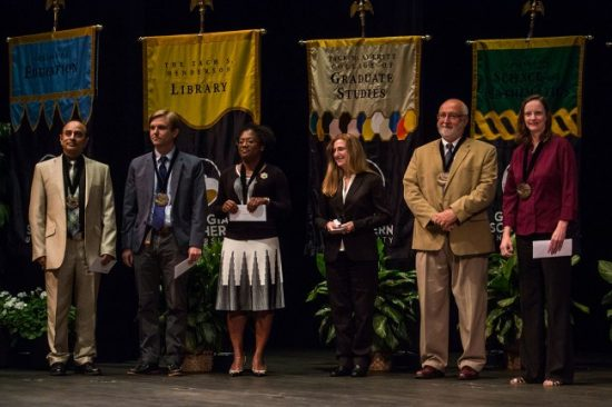 Pictured third from the left, Meca Williams-Johnson, Ph.D. received the University's Excellence in Instruction Award at the University's Fall 2016 convocation.